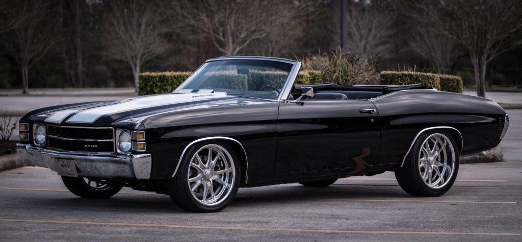 black vehicle in classic car storage