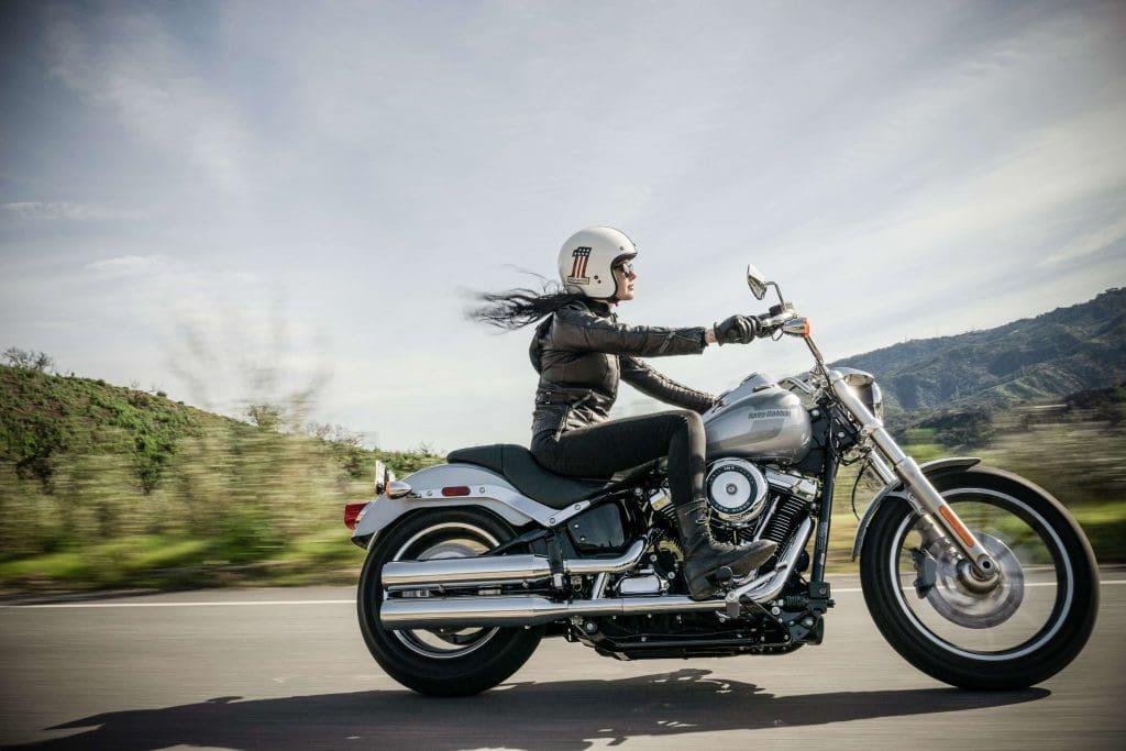 woman riding harley davidson motorcycle
