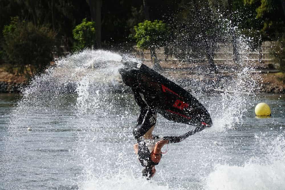 a jet skier performs a flip