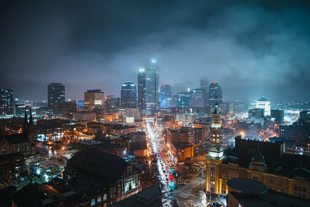 a foggy night view of downtown indianapolis in
