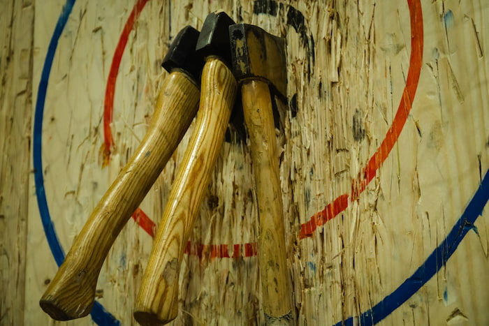 Axes in a target in an axe-throwing venue