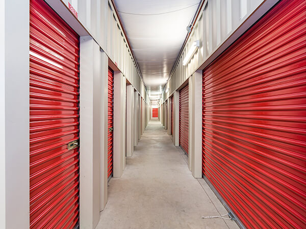 Store Space Hallway of Red Storage Units